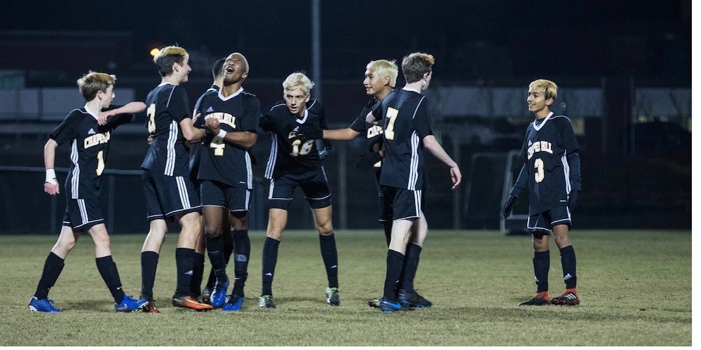 <p>Members of the Chapel Hill High School boy's soccer team celebrate during a game. Photo courtesy of Bryant Davis Jr.</p>