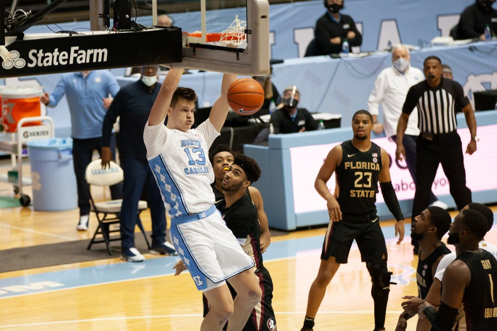 UNC first-year forward Walker Kessler (13) flushes home a dunk in Carolina's 78-70 victory over Florida State in the Smith Center, Feb. 27, 2021.