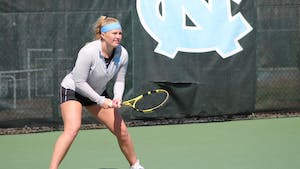 Alle Sanford prepares to return a serve during her doubles victory over Maya Tahan and Florencia Urrutia of the University of Miami on March 6, 2021.