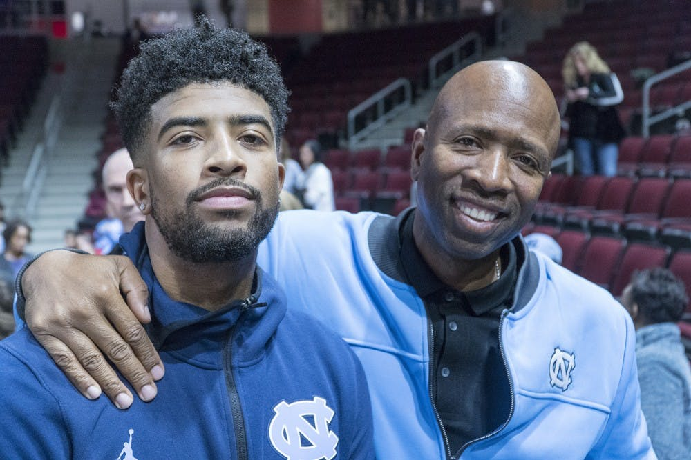 <p>K.J. Smith and Kenny Smith pictured together after UNC's 116-67 win over Elon on Nov. 9, 2018. Photo courtesy of Josh Reavis/UNC Athletics.</p>