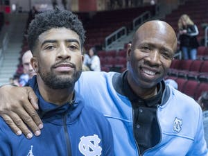 K.J. Smith and Kenny Smith pictured together after UNC's 116-67 win over Elon on Nov. 9, 2018. Photo courtesy of Josh Reavis/UNC Athletics.
