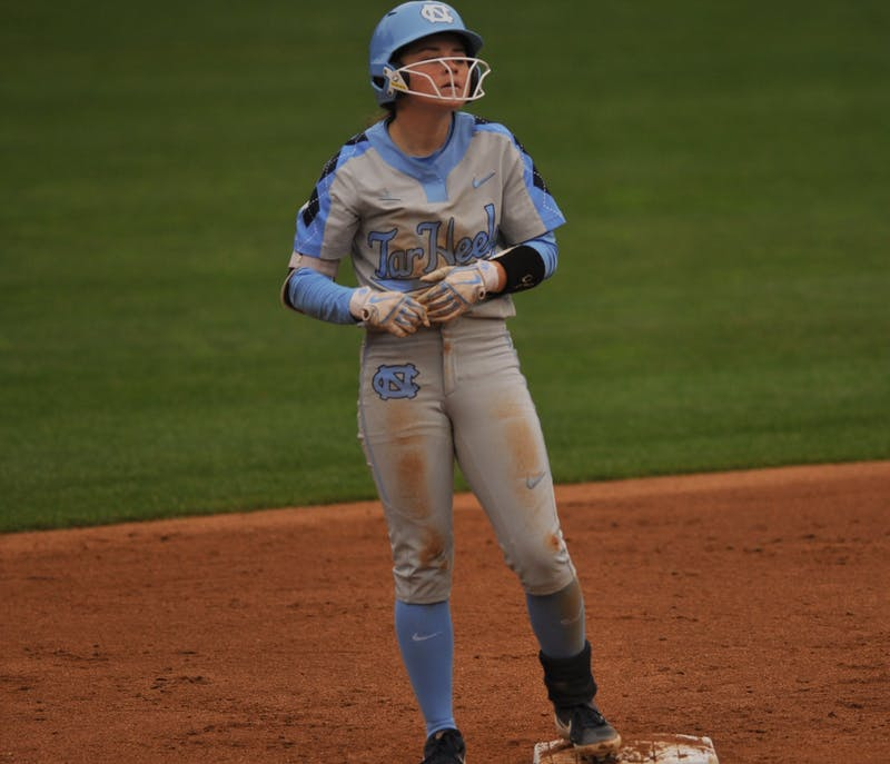 UNC sophomore Abby Settlemyre (29) catches her breath after she succesfully stole second base during a game against Elon on Wednesday, Feb. 26, 2020 in G. Anderson Softball Stadium. UNC lost to Elon 2-1.