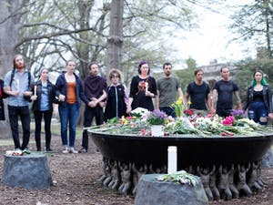 Students and community members hold hands during the Unsung Founders Memorial vigil hosted by UNC Black Congress, Thursday April 4, 2019 at McCorkle Place.