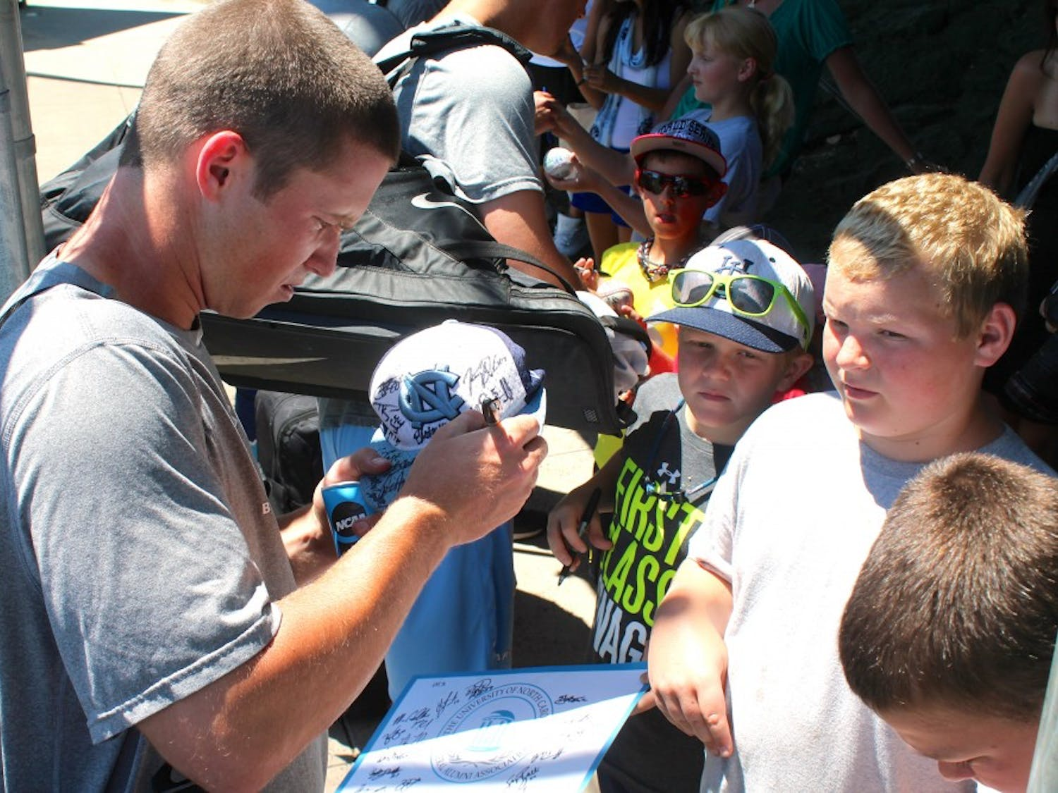 Outfielder Parks Jordan signs autographs for waiting fans after Monday's practice at Creighton's baseball field.