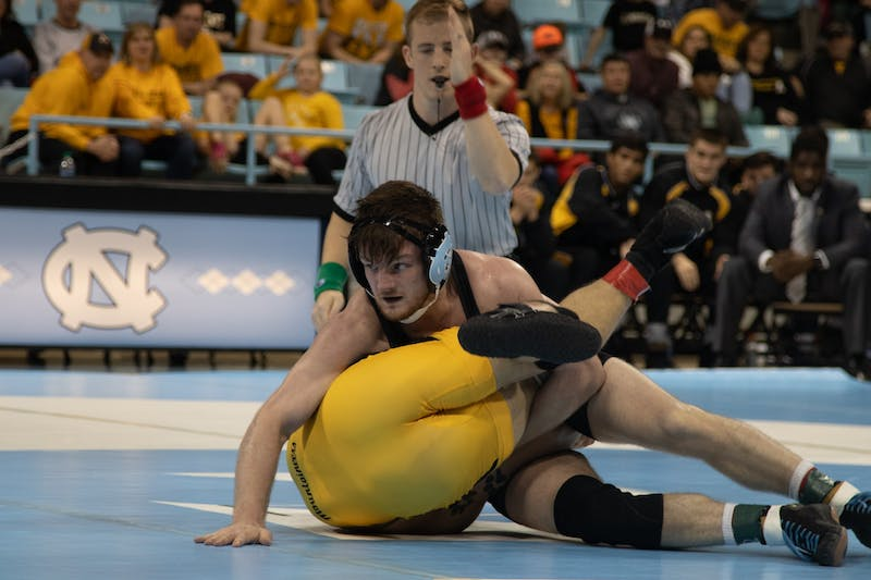 Redshirt Senior A.C. Headlee (157') attempts to pin his opponent in the UNC wrestling match against Appalachian State on Sunday, Dec. 1, 2019. Headlee's upset victory helped UNC to a 19-13 victory.