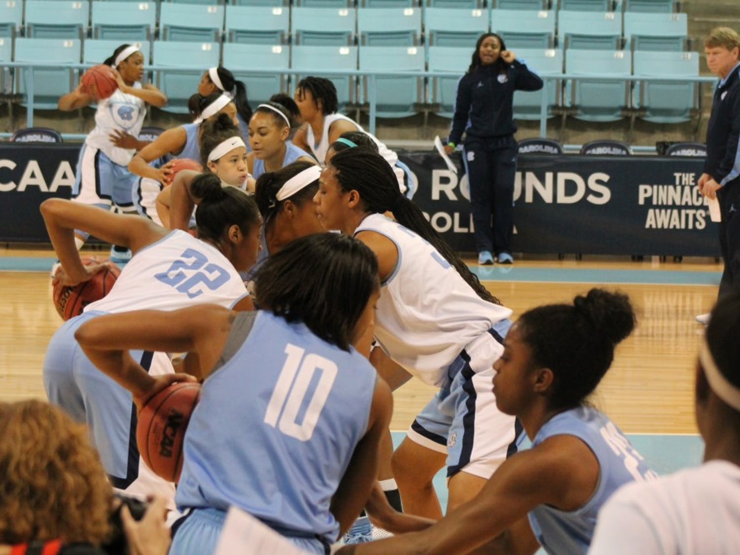 The North Carolina women's basketball team goes through a ball-handling drill during practice Saturday afternoon.