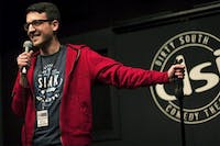 Andrew Aghapour, a Ph.D. student and stand-up writing workshop teacher, performs at N.C. Comedy Arts Festival on Feb. 5, 2015. Courtesy of Ryan Kelly Coil.