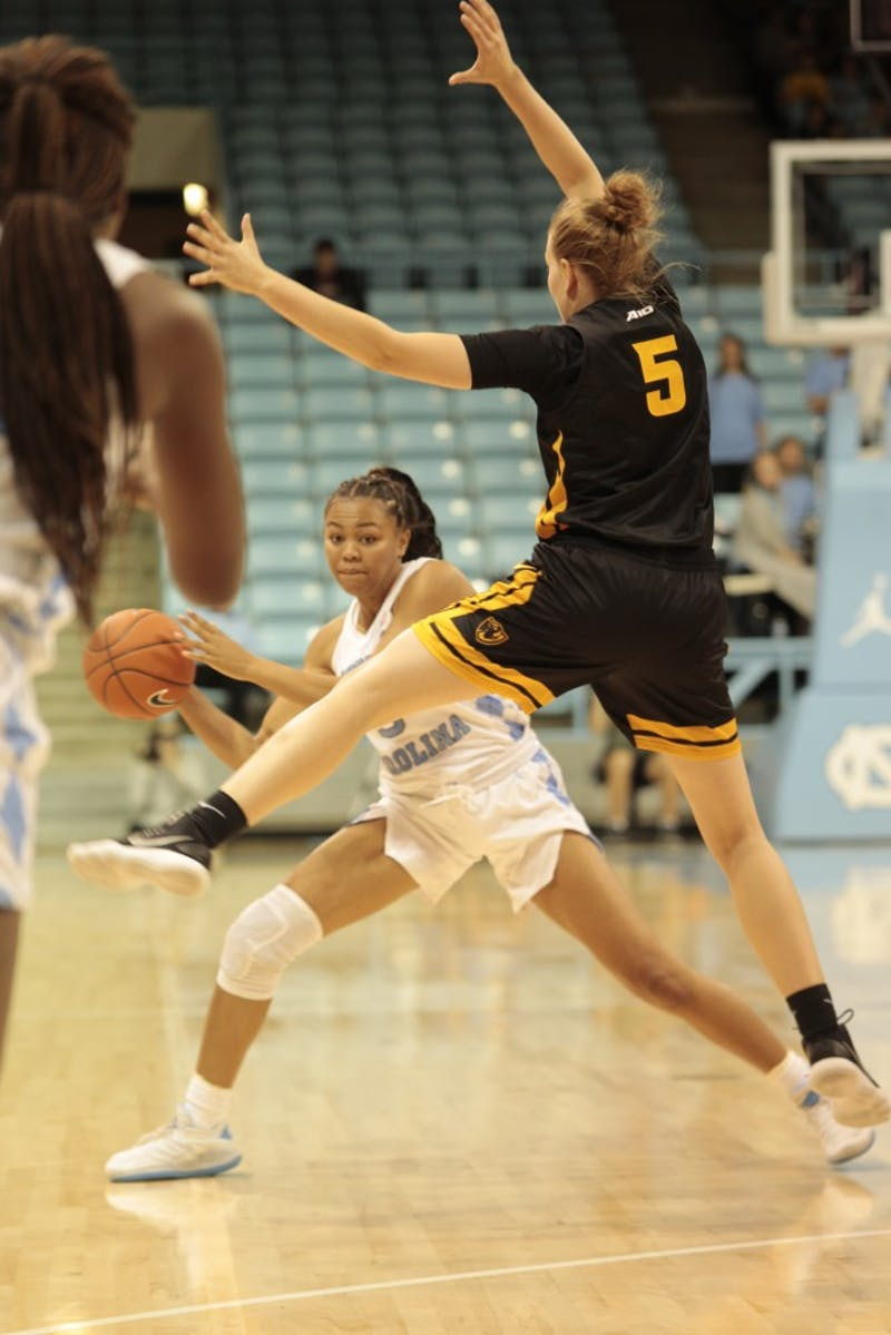 Junior guard Stephanie Watts (5) passes the ball during Wednesday's game against Virginia Commonwealth University at Carmichael Arena. UNC won 59-47.