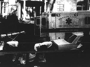 In 1995 a UNC law student shot and killed two people on Henderson Street.Orange County emergency medical professionals transport the body of one of the shooting victims.