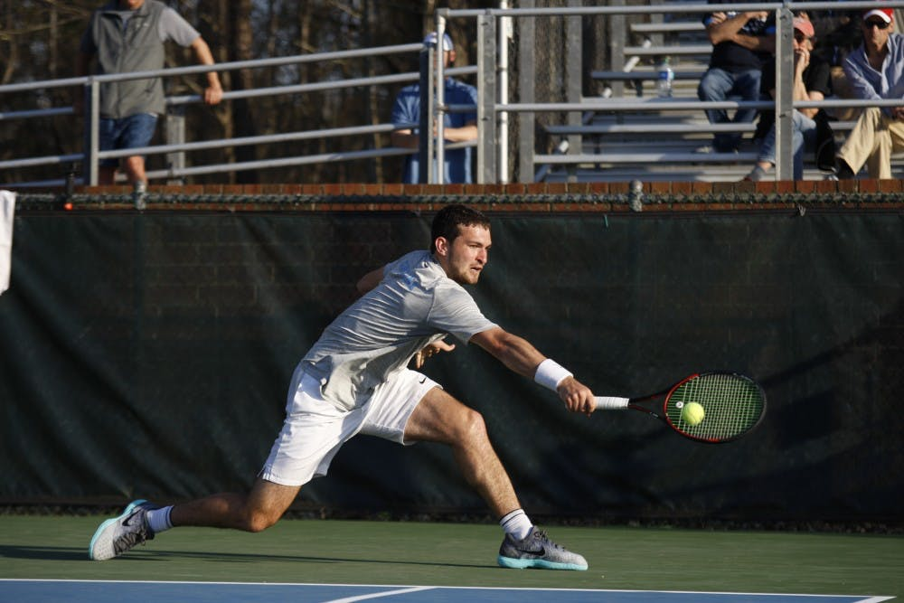 <p>UNC men's tennis junior William Blumberg returns the ball during a singles match against NC State on Wednesday April 3, 2019. UNC beat NC State 4-0.&nbsp;</p>