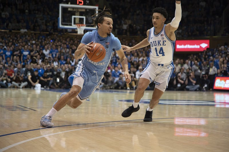 UNC first-year guard Cole Anthony (2) dribbles upcourt as Duke junior Jordan Goldwire (14) defends him. UNC lost to Duke 89-76 in Cameron Indoor Stadium on Saturday, March 7, 2020.