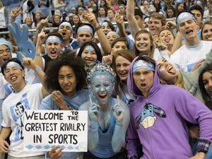 Students cheer on the UNC men's basketball team from the risers in the Smith Center during the game against Duke on March 4, 2017.