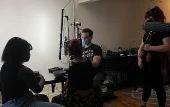 Members of a film crew work behind the scenes wearing masks. While the COVID-19 pandemic has caused major changes in Hollywood as productions get shut down and release dates are pushed back, student filmmakers are also forced to make modifications to their plans and projects. Photo courtesy of Katia Carmichael.