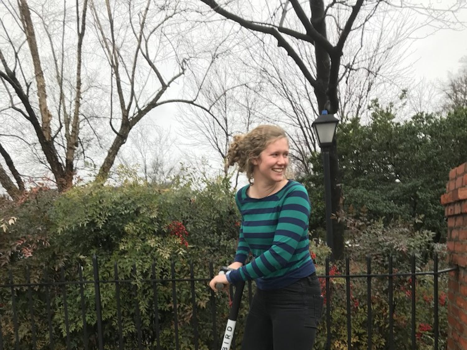 College student Julia Stevens uses a Bird Scooter in downtown Raleigh.