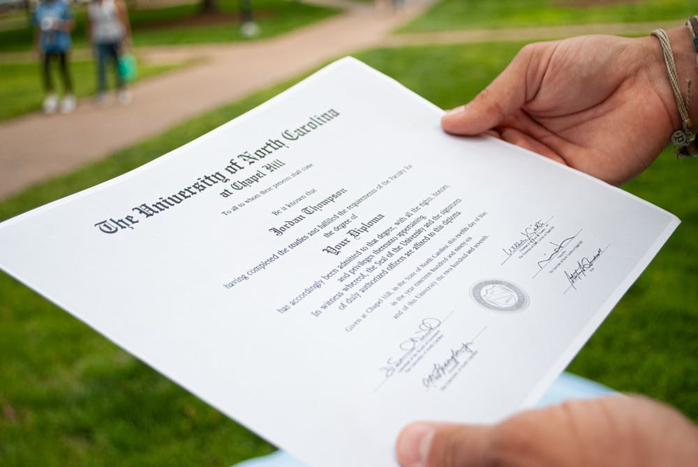 <p>DTH Photo Illustration. The Registrar notified seniors that they will have the option to choose the name that appears on their diploma in ConnectCarolina.</p>
