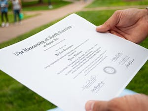 DTH Photo Illustration. The Registrar notified seniors that they will have the option to choose the name that appears on their diploma in ConnectCarolina.