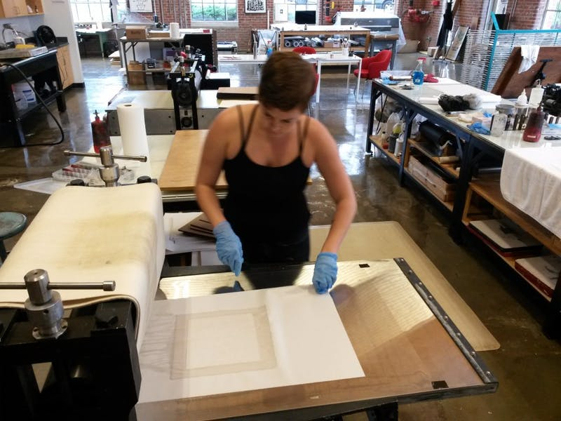Jessica Jones is proofing a copper plate etching at Supergraphic. Photo courtesy of Jessica Jones.