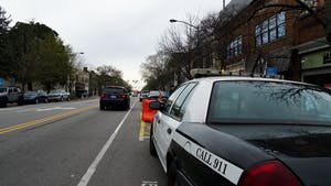 A City of Chapel Hill police car is parked on Franklin Street on Sunday, March 28, 2021. The town said that there would be more monitoring of pedestrian areas on main streets.