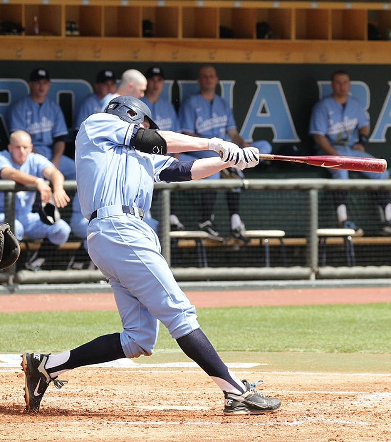 Third baseman Colin Moran connects with the ball in the bottom of the fourth on April 3. The Tar Heels completed a three-game sweep of the Clemson Tigers with a 5-4 victory on.