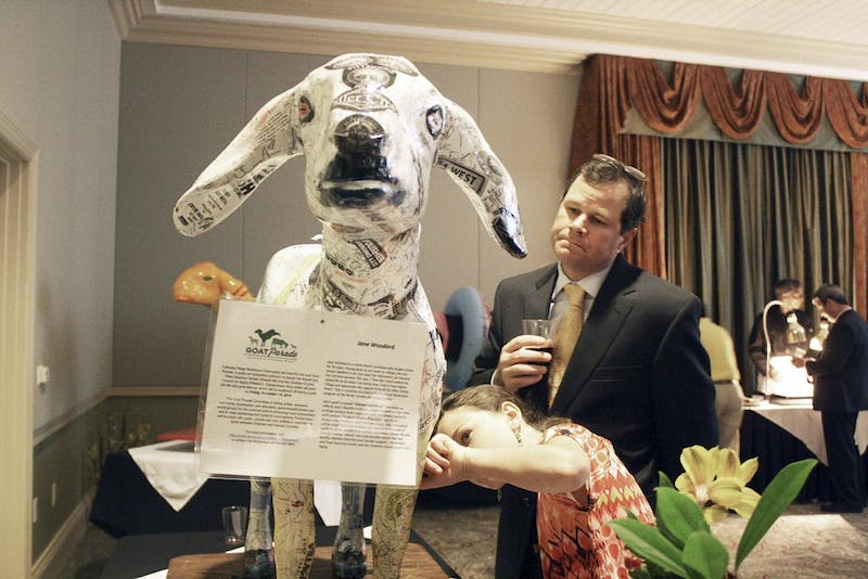 "The Goat Parade Auction was held at the Galloway Ridge Retirement Community on Friday, Nov. 14. The goats were showcased around the community and then auctioned off to raise money for the senior center. Greg and Tyler Rhinehardt  admire  ""Vincent van Goat"" was painted by Jane Woodard. ""Every time you look at it you see something different."" -Greg"