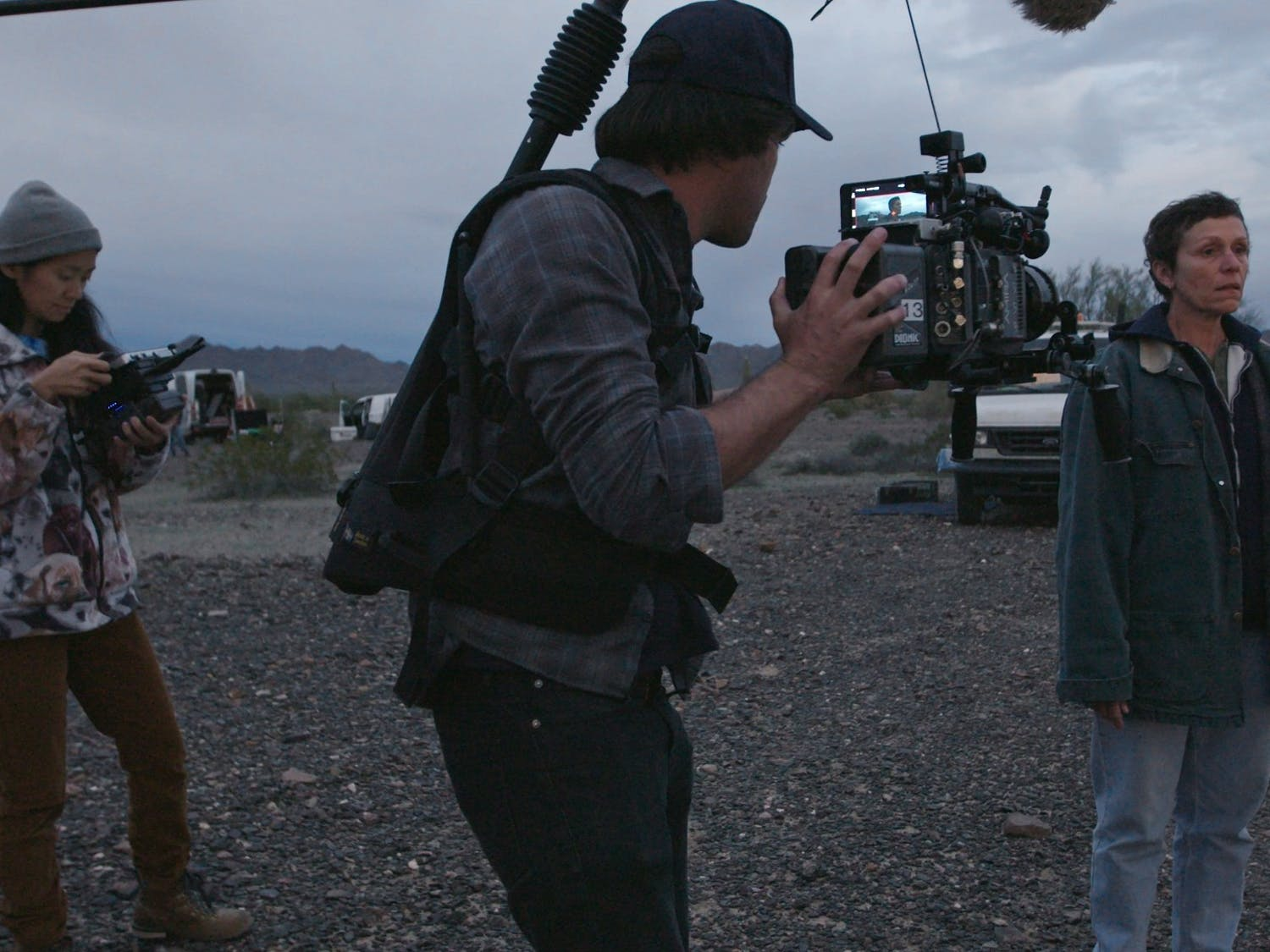 "From left, Director and Writer Chloe Zhao, Director of Photography Joshua James Richards and Frances McDormand on the set of ""Nomadland."" Photo courtesy of Searchlight Pictures/2020 20th Century Studios/TNS"