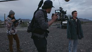 """From left, Director and Writer Chloe Zhao, Director of Photography Joshua James Richards and Frances McDormand on the set of """"Nomadland."""" Photo courtesy of Searchlight Pictures/2020 20th Century Studios/TNS"""
