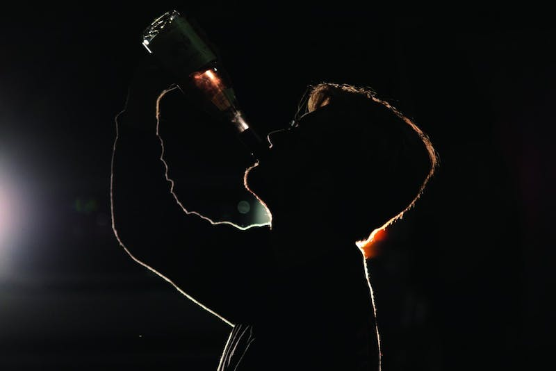 Photo illustration. Navigating college party and binge drinking culture makes it difficult for students who are recovering from alcoholism.