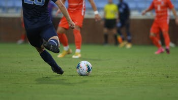 A UNC player prepares to kick a ball during a game against Clemson at Dorrance Field on Friday, Oct. 9, 2020. UNC won the game 1-0.