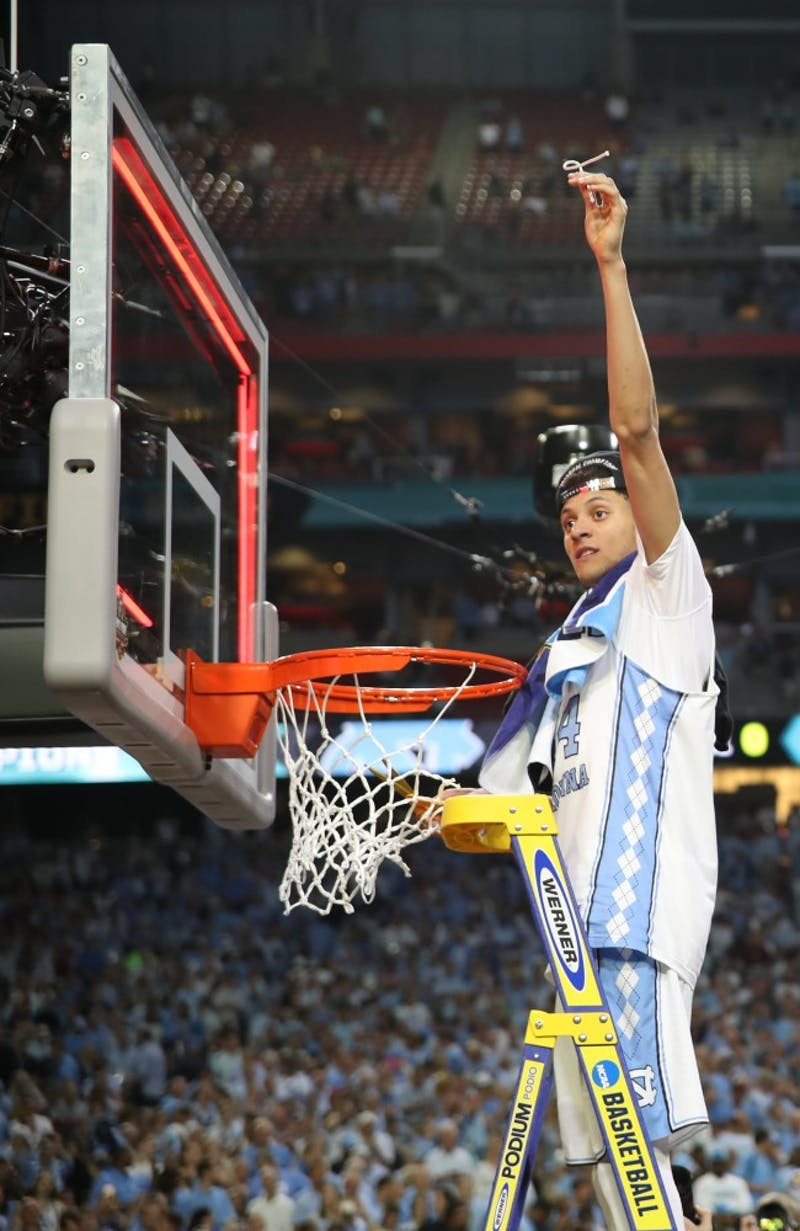 North Carolina wing Justin Jackson (44)  holds up his part of the cut down net after defeating Gonzaga 71-65 in the NCAA men's basketball Championship Monday night in Phoenix.