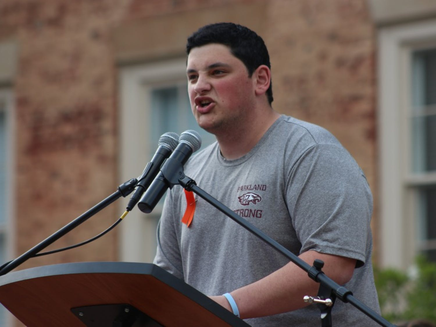 First year student Joshua Romero, lead organizer of the rally expresses the need for reformed gun laws at the UNC Rally for Our Lives event in Polk Place on Wednesday evening.