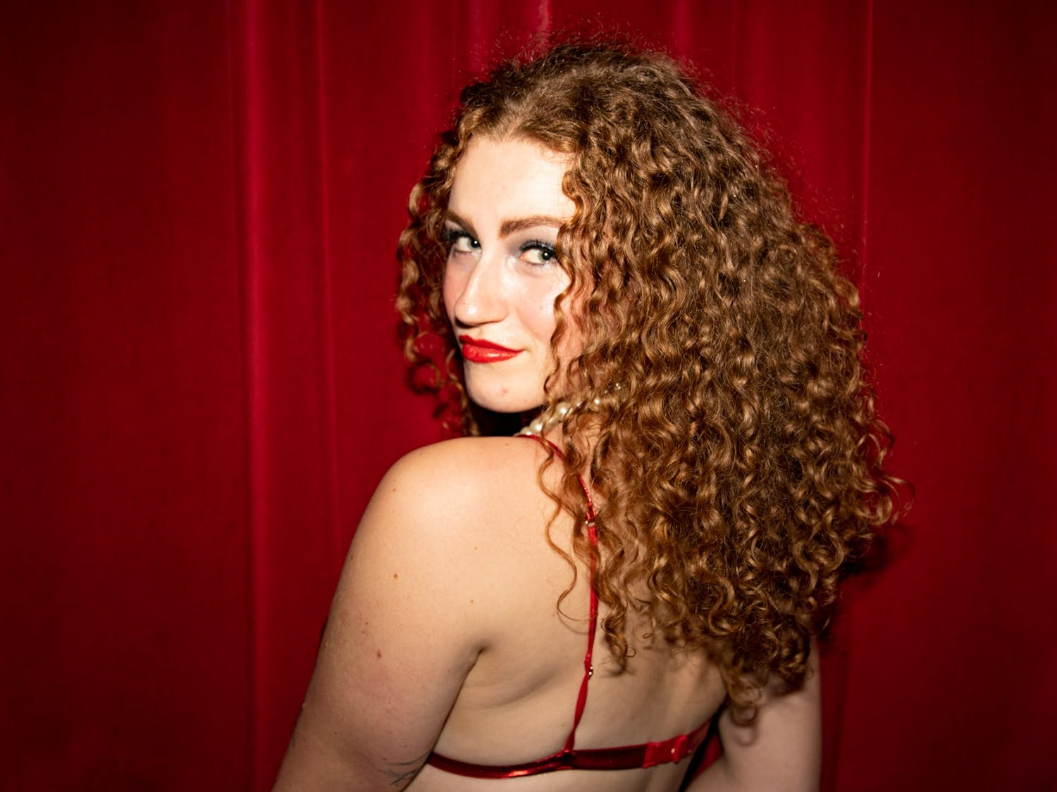 UNC senior Olivia Sullivan poses for a portrait before an Oct. 26 technical rehearsal of the Rocky Horror Picture Show at the Varsity Theatre. The production is an annual tradition of the UNC Pauper Players, and Sullivan is portraying the lead, Dr. Frank-N-Furter.