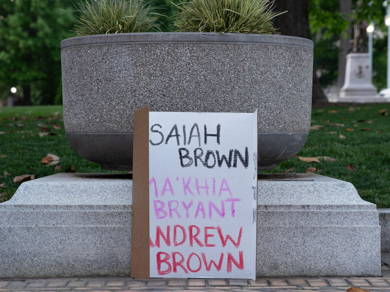 A sign with the names of victims of police violence sits outside the North Carolina State Capitol Building on April 23 2021.