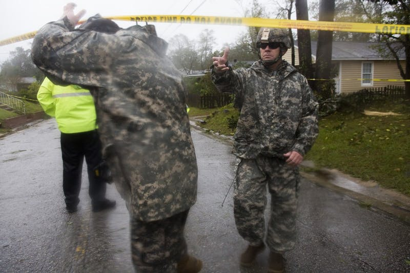 Members of the National Guard exit the scene where a fallen tree, due to hurricane Florence, critically injured a father and took the life of a mother and infant on Friday, September 14th in Wilmington, NC. The National Guard was one of many first-responders that rendered assistance in the recuse and subsequent recovery efforts at a residence on Mercer Ave, in Wilmington.