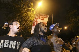 Protestors march through the streets of Charlotte on September 22nd in response to the police shooting of Keith Scott.