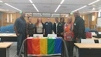 Photo Courtesy of April Callis, assistant director of the UNC LGBTQ Center Dr. April Callis and co-facilitator Lee Roberts with members of the Carolina Black Caucus celebrating a successful Safe Zone training at UNC Gillings School of Global Public Health.