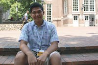 Lawrence Bacudio, a NCSSM graduate and future freshman at UNC, attends orientation despite financial issues as he awaits his green card.