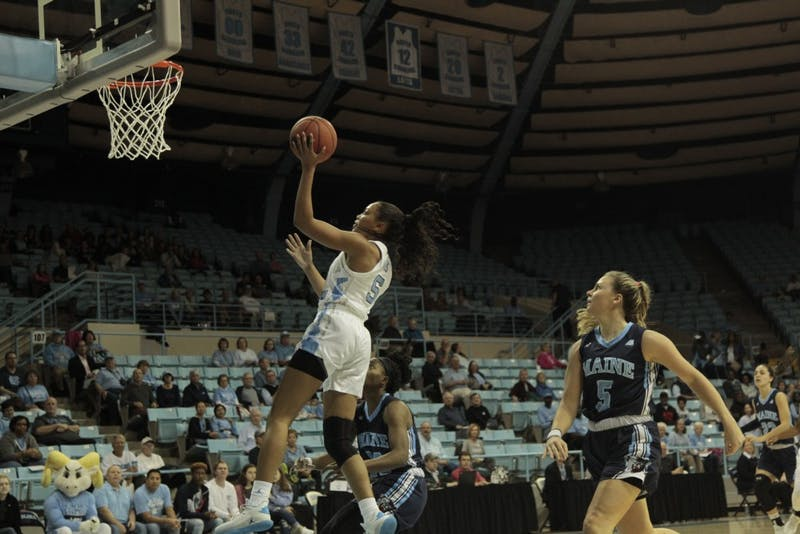 UNC junior guard Stephanie Watts (5) goes for a layup during the game against Maine on Sunday, Dec. 2, 2018. UNC lost to Maine 85-73. Watts scored 16 points.