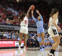 Tar Heel redshirt junior guard Stephanie Watts (5) attempts a shot against Wolfpack Senior Forward DD Rogers (22) during the UNC's 64-51 win against NC State at Reynolds Coliseum on Sunday, Feb. 3, 2019 in Raleigh, NC. The Tar Heels Women's Basketball Team (14-9) handed the Wolfpack (21-1) their first loss of the season.