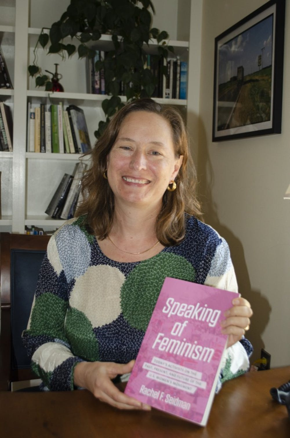 <p>Rachel Seidman holding her book, <em>Speaking of Feminism</em>.&nbsp;</p>
