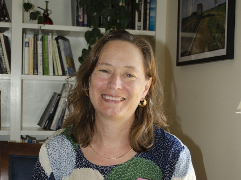 Rachel Seidman holding her book, Speaking of Feminism.