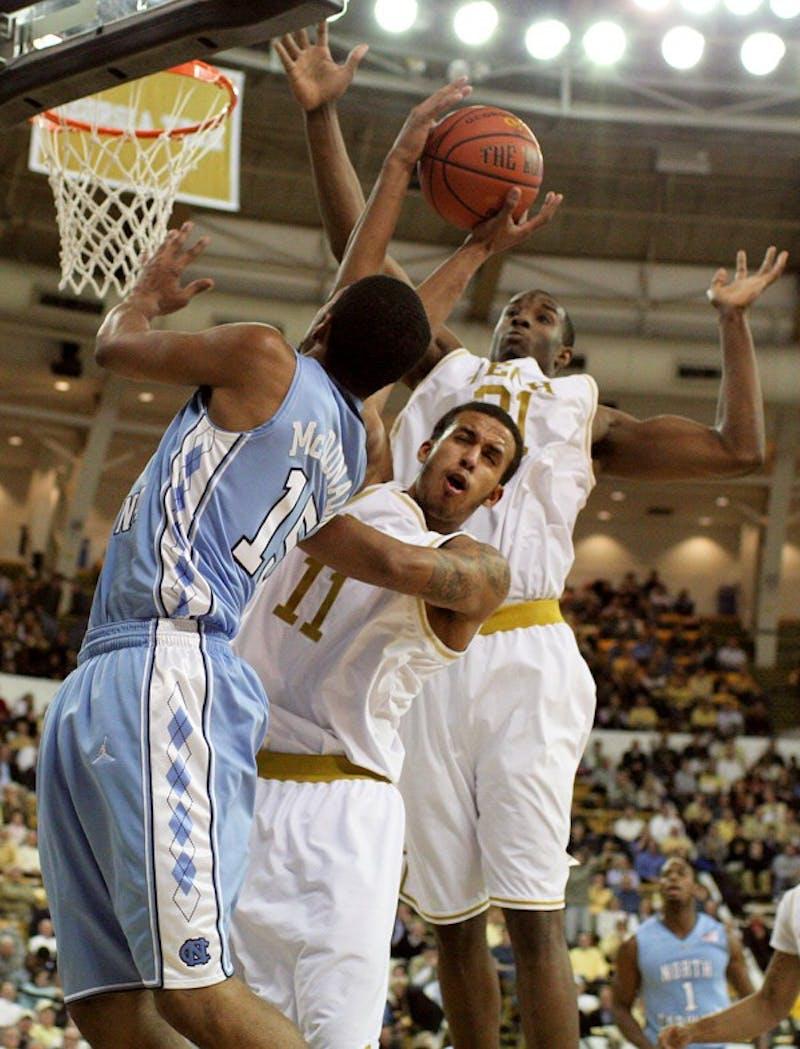 UNC freshman Leslie McDonald has his shot blocked by Georgia Tech's Brian Oliver.