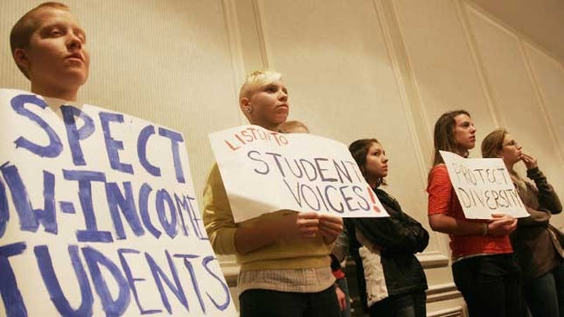 Protestors at the Board of Trustees meeting Thursday morning