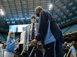 UNC men's basketball new head coach Hubert Davis greets people ahead of his appointment press conference at the Smith Center on April 6, 2021.