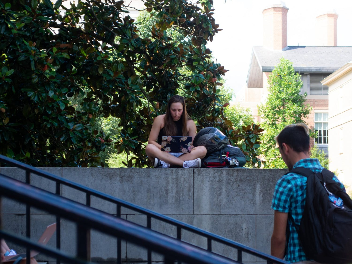 A student studies near the front steps of Wilson Library on the first day of classes, Aug. 18.