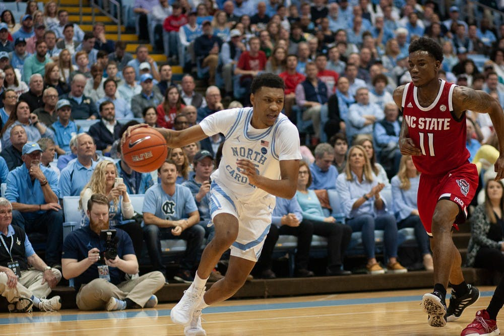 <p>UNC graduate guard Christian Keeling (55) drives the ball up the court against N.C. State in the Smith Center on Tuesday, Feb. 25, 2020.&nbsp;</p>