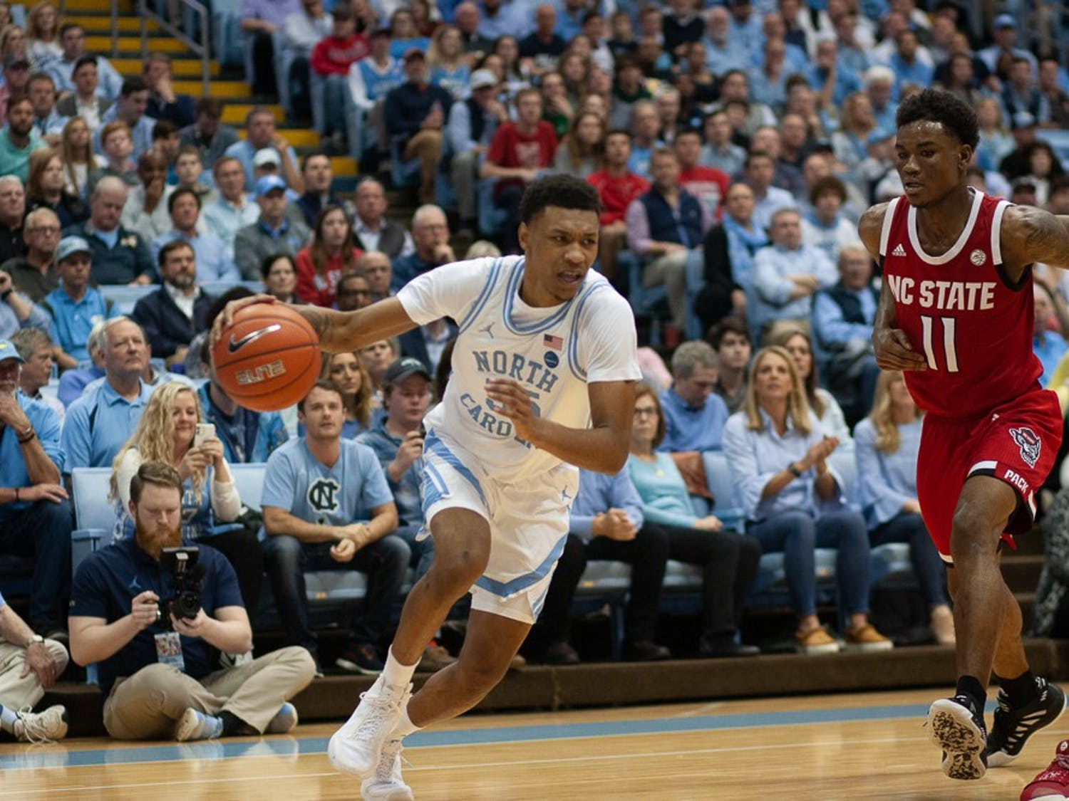 UNC graduate guard Christian Keeling (55) drives the ball up the court against N.C. State in the Smith Center on Tuesday, Feb. 25, 2020.