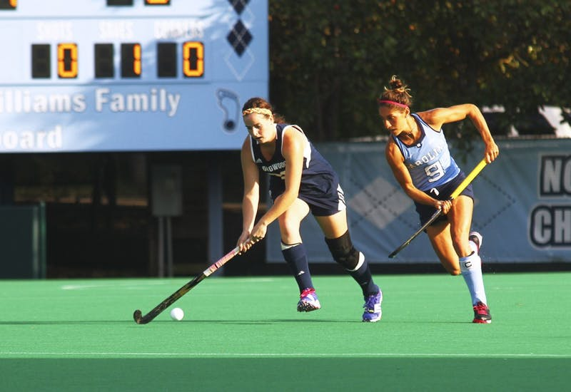 The UNC field hockey team beats Longwood on Friday afternoon, Oct. 9, with a score of 8-1. Emily Wold (9) defends an opponent.