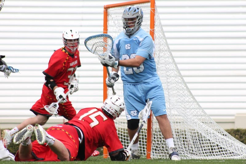 UNC goalkeeper Kieran Burke (26) defends a goal from a Maryland player. UNC won 11-8.