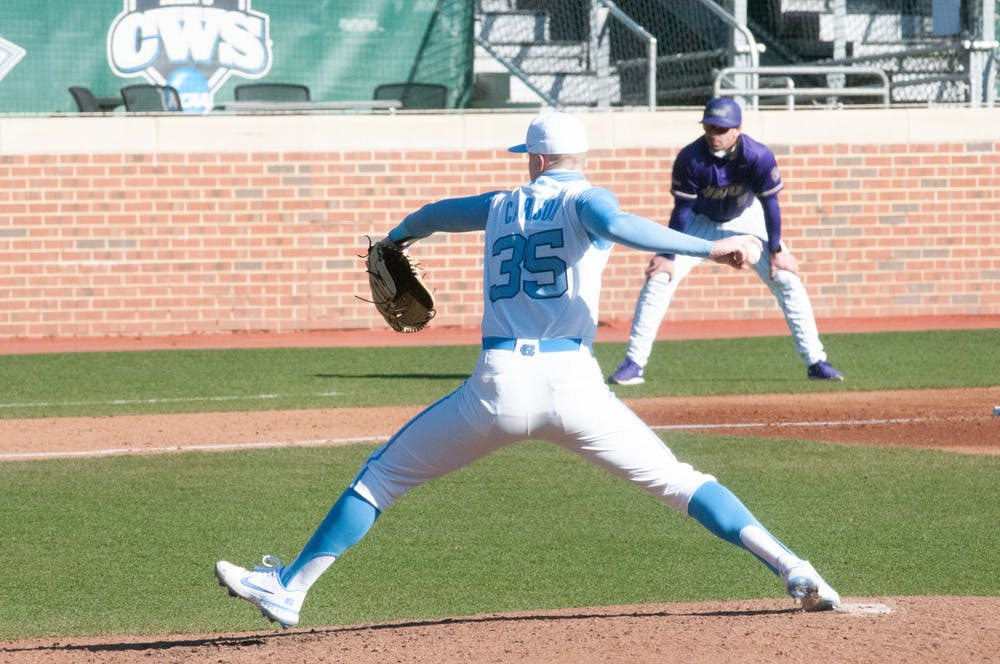 <p>UNC first-year pitcher Max Carlson (35) delivers a pitch during UNC's 7-4 win over James Madison at Boshamer Stadium, Feb. 20, 2021.</p>