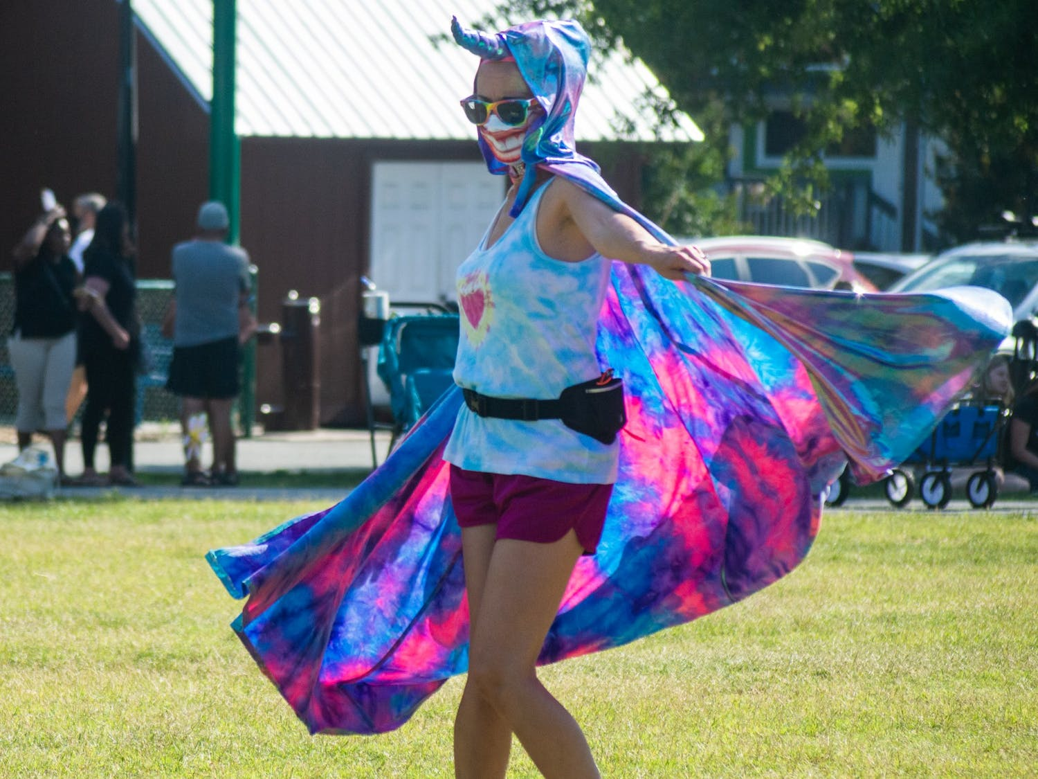 A community member dances at the Chapel Hill Carrboro Small Town Pride Food Truck Rodeo and Dance Party in Carrboro on Thursday June 24, 2021.
